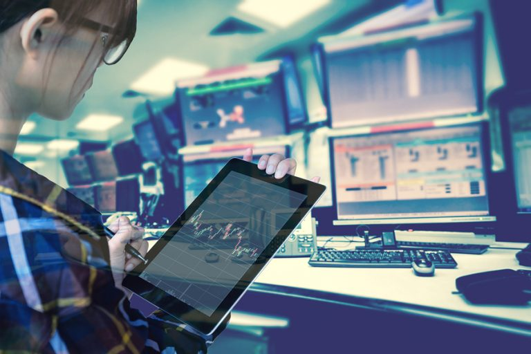 Double exposure of women Engineer in hipster shirt working with tablet in control room of oil and gas platform or plant industrial for monitor process, business and industry concept